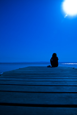 lonelyness: A girl resting in a quiet, blue, and very beautiful night