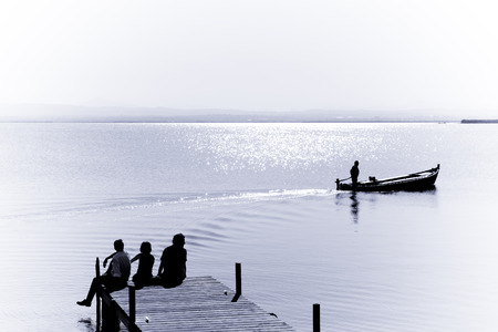 That´s the life in the Albufera, lonely old fishermen and  turist groups relaxing. Stock Photo - 1767623