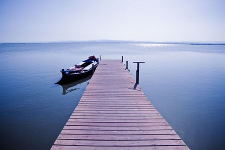A boat tied in a footbridge, taken in the Albufera, Valencia. Stock Photo