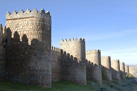 patrimony: Medieval city walls in Avila, Spain .