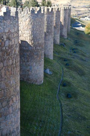 avila: Medieval city walls in Avila, Spain .