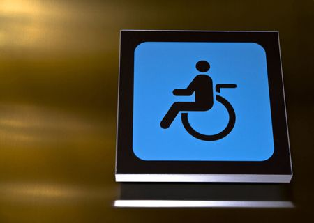 Symbol for a restroom adapted to wheelchair users. Stock Photo - 2159379