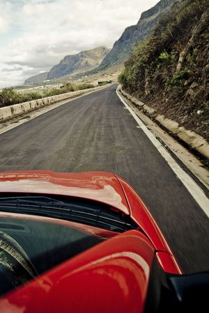 Driving at high speed by mountain road . Stock Photo - 2167494