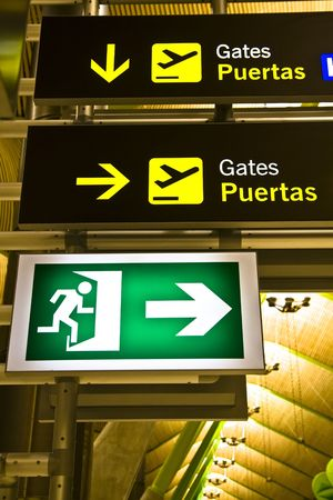 Gate and exit sign panels in airport, Madrid. photo