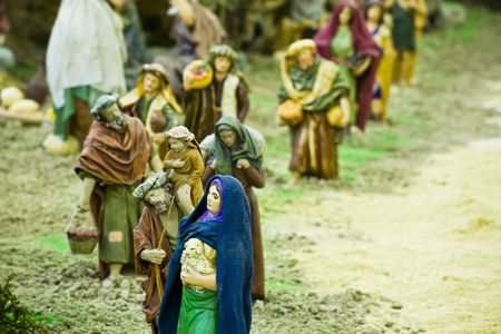 believers: Believers in queue to give their presents to  Jesus. Stock Photo