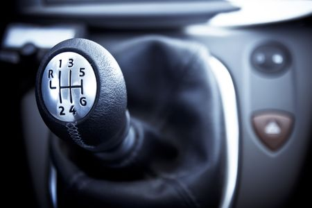 reversing: Closeup on a gearshift. Stock Photo