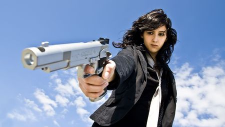 pointing gun: Mafia girl shooting at cold blood