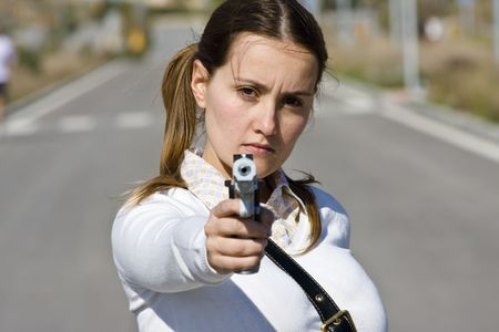 scholar: Scholar girl pointing at camera with gun Stock Photo