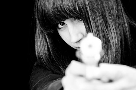 assasin: Mad woman aiming at you with a gun. Stock Photo