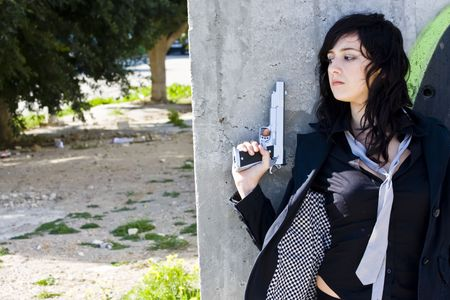 violence and trigger: Hidden mafia woman with gun Stock Photo