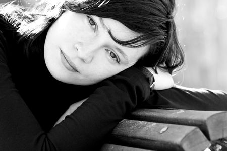 Black and white portrait of good looking woman in bench Stock Photo - 2546428