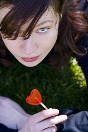 Young woman with red candy in her hands Stock Photo - 2546102