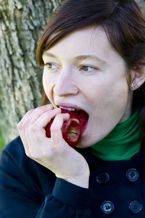 Green eyed young girl with apple in winter fashion Stock Photo - 2546439