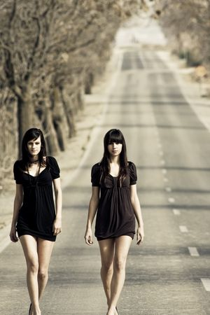 defiant: Two couple of young models parading in the middle of the road Stock Photo