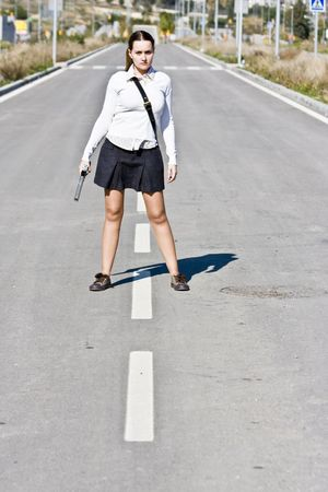 Young girl portrait with gun photo