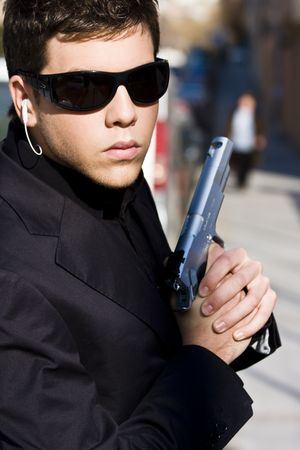 special service agent: Alertness secret agent ready for action over urban background