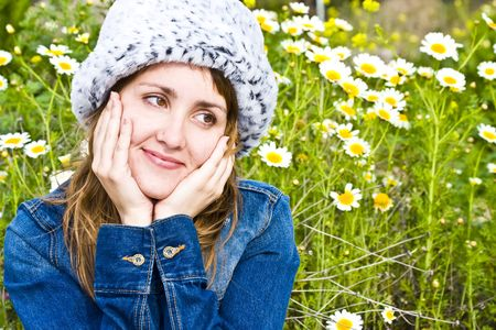 Woman portrait surrounded by flowers. photo