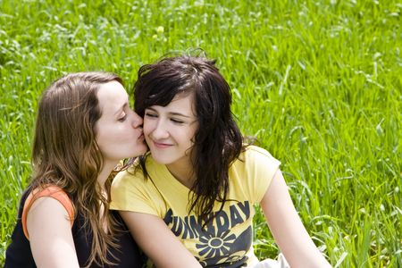 Friendly kiss betwen two young women Stock Photo - 3015607