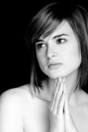 Young praying woman portrait in black and white tone.