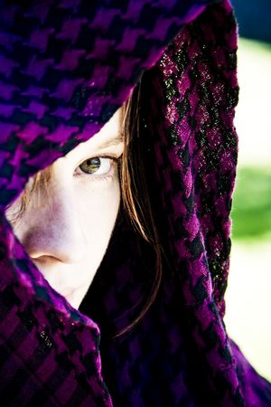 Staring woman portrait covered by violet veil photo