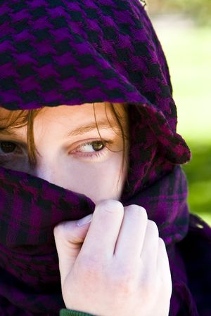 Staring woman portrait covered by violet veil Stock Photo - 3065294