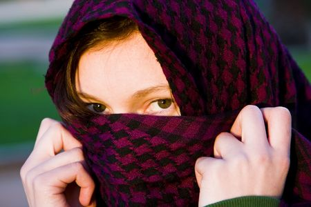 Staring woman portrait covered by violet veil Stock Photo - 3065274