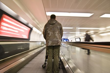 Soldier at airport performing leaving to war or returning home.