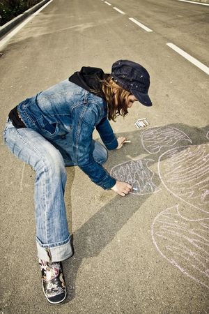 grey haired: Young artist painting on the street