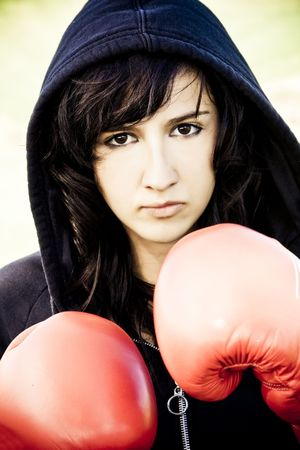 Young female boxer with red gloves photo