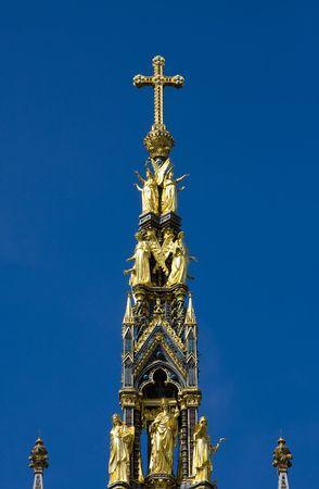 Christian golden cross in the top of the Albert Memorial, London. photo