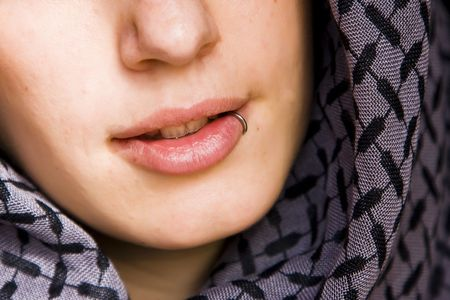 Sensual pierced mouth covered by violet veil Stock Photo - 3235637