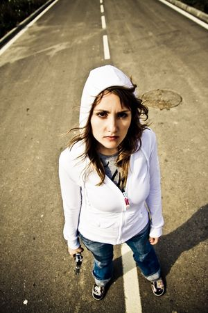 Young woman with gun, grunge style. photo