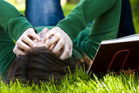 Exhausted student over the grass in the park Stock Photo - 3237638