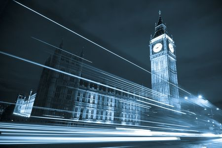 vignetting: Nocturne scene with Big Ben behind light beams, blue toned.