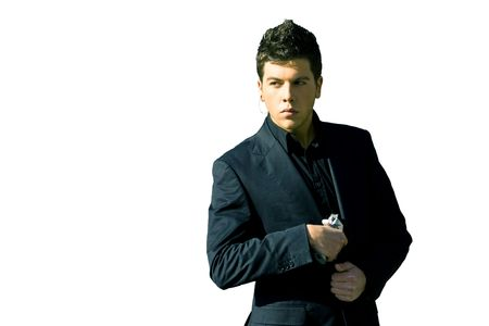 advised: Male model performing secret agent with gun Stock Photo