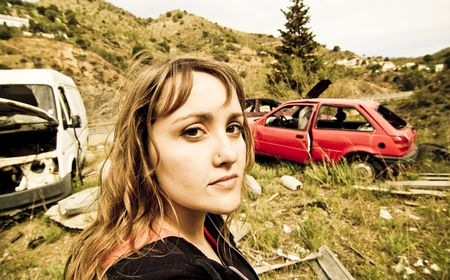 junked: Young woman in the scrapyard