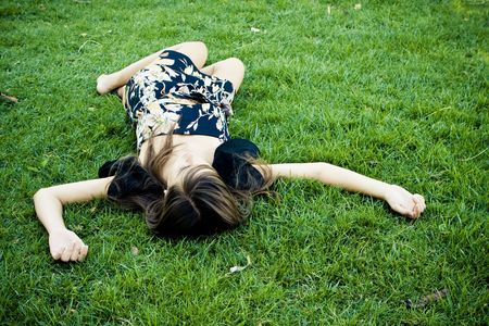 Died or resting woman laying on the grass. Stock Photo