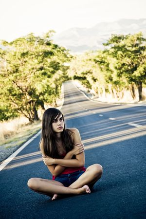 Lost beautiful girl in the middle of the road photo