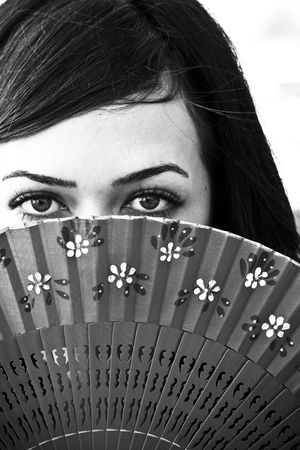 Spanish woman behind traditional fan. Stock Photo - 3433038