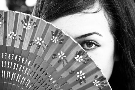 Spanish woman behind traditional fan. Stock Photo - 3433329