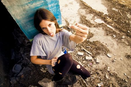 bad manners: Tough grunge woman in dirty location.