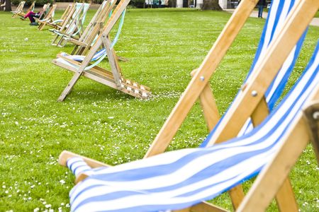 hyde: Empty deck chairs at St Jame´s London Park. Focus on the second pair of chairs.