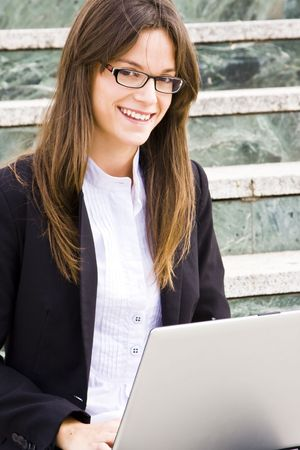Young businesswoman staring at camera sited on stairs. Stock Photo - 3433307