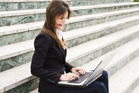 sited: Hard worker businesswoman sited on stairs.