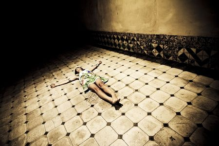 Young seminude crucified woman on the floor photo