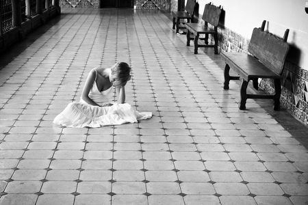 Young woman in white dress on the floor photo