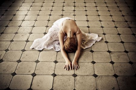 Young blond woman in floor showing obedience Stock Photo