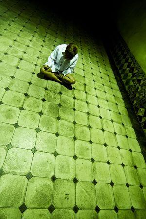 Lone woman in spooky corridor