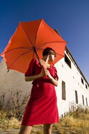 Woman with umbrella, both in red. photo