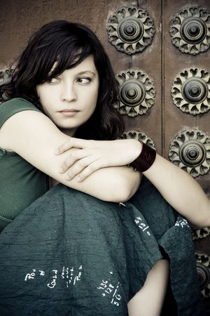 tormented: Thoughtful beautiful woman over antique background.
